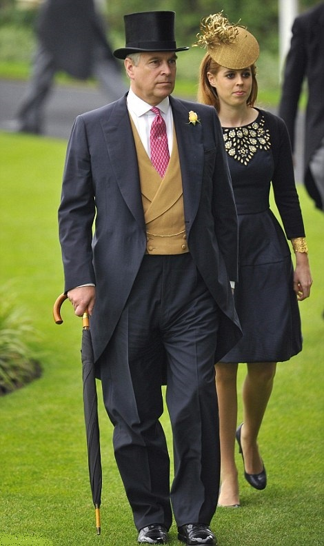 Prince Andrew, Duke of York and his eldest daughter, Princess Beatrice, make their way through the grounds on the third day of Royal Ascot 2013