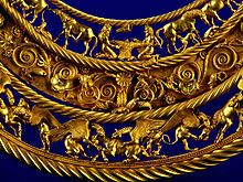 Gold Scythian pectoral, or neckpiece, from a royal kurgan in Tolstaya Mogila, Ordzhonikidze, Ukraine, dated to the second half of the 4th century BC. The central lower tier shows three horses, each being torn apart by two griffins.