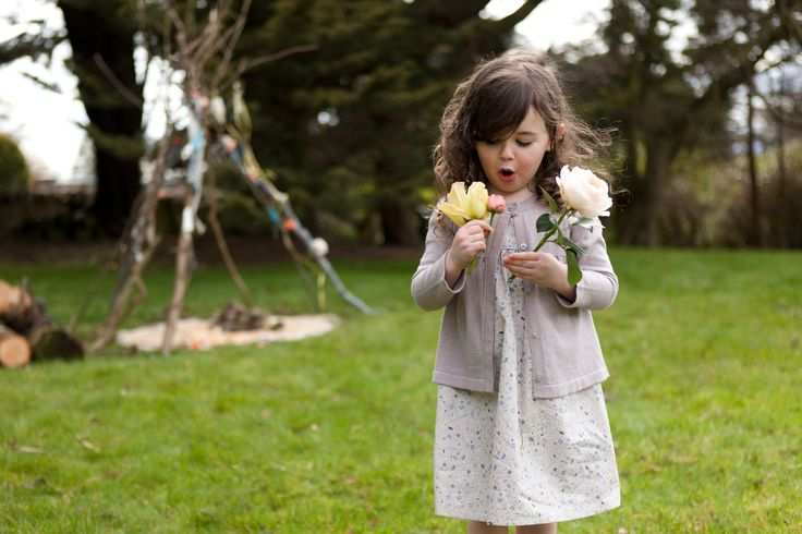 Floral A-line dress and knitted cardigan with long sleeves and branded buttons, both Leigh Tucker Willow