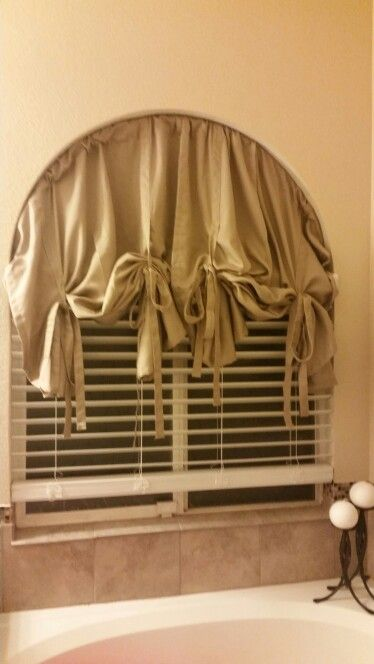 Hula hoop with some curtains.  Finally something decent to cover my half moon window.