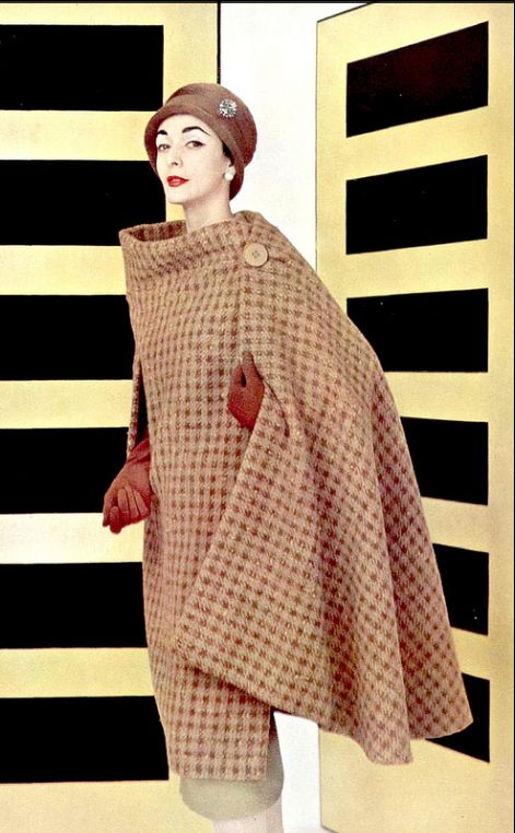 1956 - Kouka Denis in Givenchy's translation of the cape in wool houndstooth in shades of Autumn, photo by Pottier