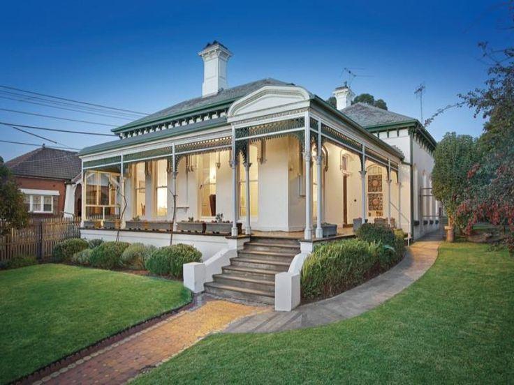 Rendered brick victorian house exterior with porch & landscaped garden - House Facade photo 525201