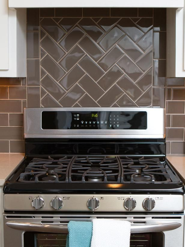 tile backsplash takes a different pattern behind the stove than behind