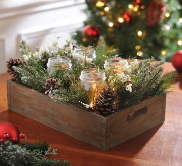 Your Christmas decor will appear homemade with our new Mason Jar Pine Arrangement! Simply place a candle within this rustic centerpiece and watch as it captivates the room! #Kirklands #Home #CozyChristmas #RusticCenterpiece