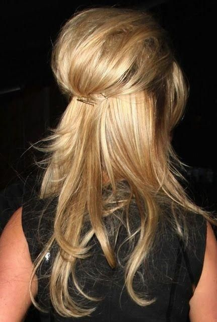 pinned back hairstyle with a poof/bump cute