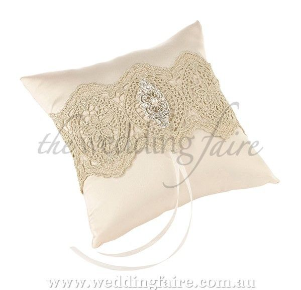 Gold Lace Ring Pillow - The Wedding Faire  our gorgeous vintage inspired wedding ring pillow is covered in ivory satin and decorated with a gold lace band, adorned with a rhinestone & pearl embellishment.  perfect for gold or vintage wedding themes.  18 cm x 18 cm.