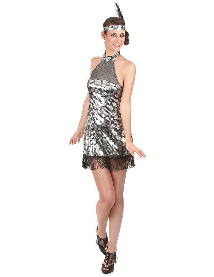 Disfraz de charlestón para mujer: Este disfraz de charlestón para mujer, color plateado, se compone de una cinta para el pelo y un vestido a juego (zapatos no incluidos)El vestido brilla y la parte inferior está...