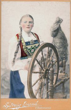 An undated photograph of an unnamed spinner from the studio of Solveig Lund of Christiania (now Oslo), Norway, probably dating from right around the turn of the twentieth century. Note that all colors other than black, white, and gray in the photograph are applied by hand. Photo provided by Marcy Moffet.