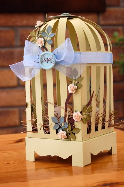 Adorable paper birdcage for Easter! No instructions (buy on Etsy?), but so cute! I'm sure we could figure it out...