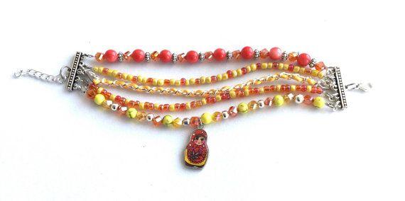 Russian doll bracelet orange and yellow beaded multi strand