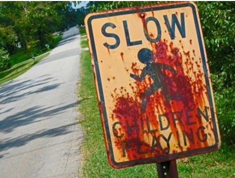 Rusty sign...looks like blood. SLOW, Children Playing.