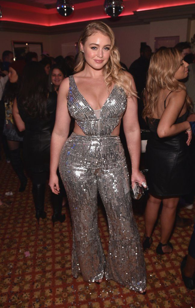 Wearing a sequined cutout jumpsuit that was a vintage find from Paris.              Image Source: Getty / B...