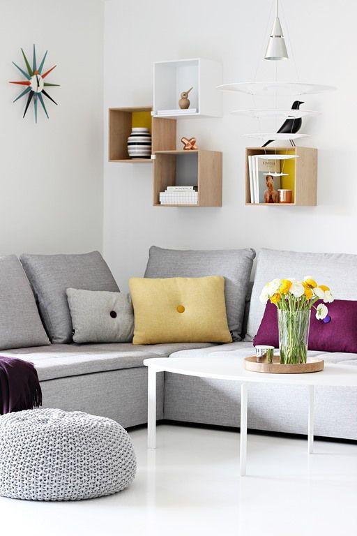 Muuto Stacked Shelving | HAY Dot Cushions | Architectmade Bird | Vitra Eames House Bird and Nelson Sunburst Clock