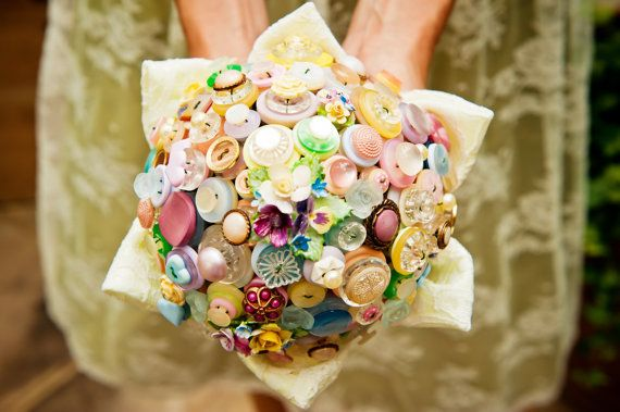 Such a unique idea. I don't think I would do it, but the colors are charming. | Button Bouquet | 20 Cute And Quirky Wedding Bouquet Ideas