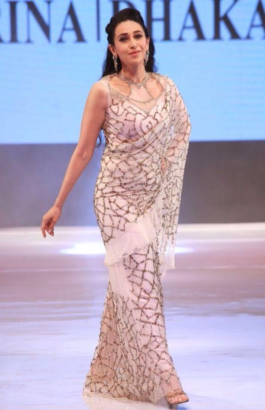 Karisma Kapoor showcases fashion designer Rina Dhaka's creations during Ambience Fashion Weekend 2016 in New Delhi, on Nov 6, 2016.