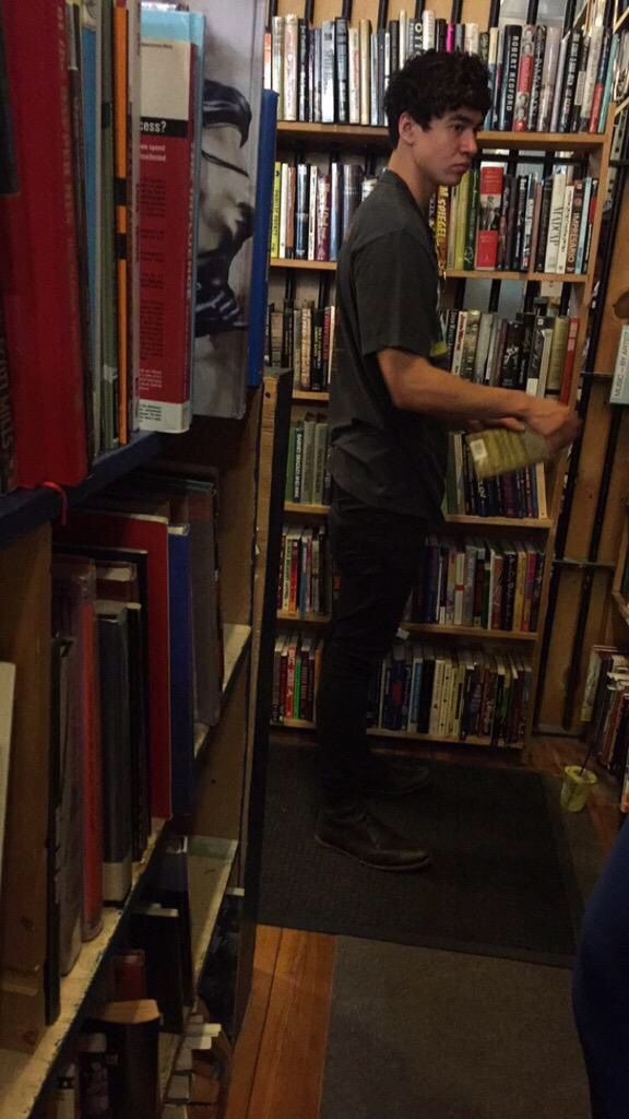 Imagine You go to the library and saw Calum came up and hugged you and he help you find a book.