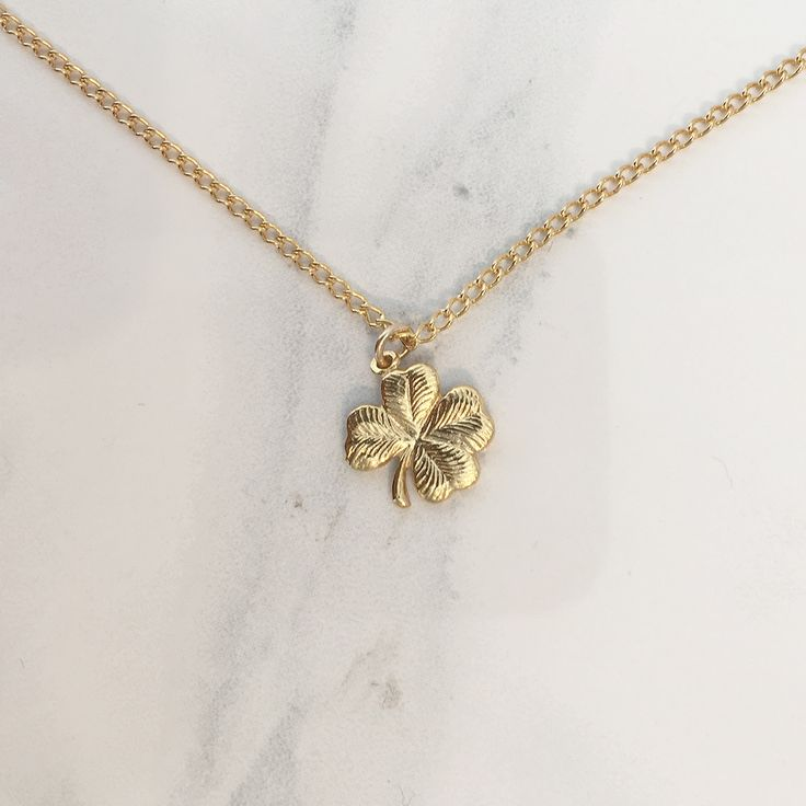 This stunning four-leaf clover gold plated pendant necklace makes a beautiful…