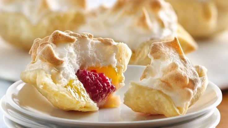 Serve these delicious mini pies filled with lemon curd, raspberry and meringue - a wonderful dessert that's made using Pillsbury® refrigerated pie crust.
