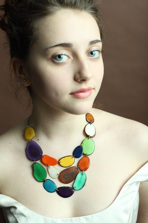 Necklace by veronicarileymartens on Etsy. Made from dried, sliced and dyed Tagua nuts!