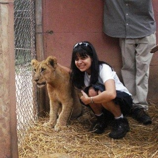 Me with a lion cub in Zimbabwe :)