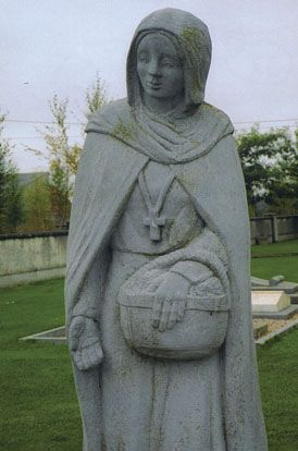 Statue of St. Brigid, County Kildare - In the center of the cross on Brigid's chest is a crescent moon. It's believed to be a sign connecting the old world with the new as Brighid embodies Pagan Celtic and Christian Celtic Ireland.