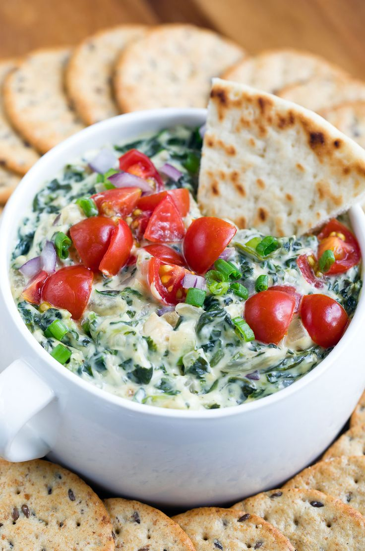 This healthy hot spinach artichoke dip is going to rock your world! Dive in with a few toasty chips and a pile of crunchy veggies and be prepared to hover..