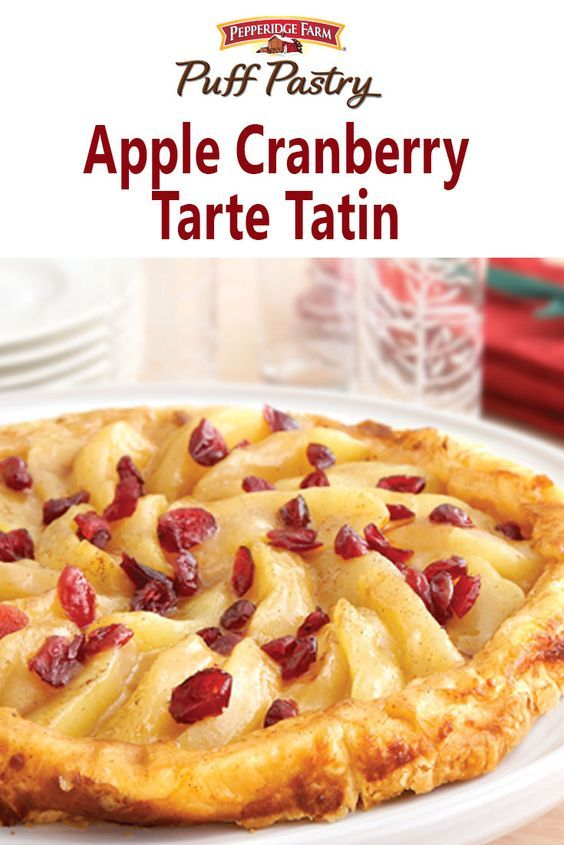 Apple Cranberry Tarte Tatin Recipe. An elegant dessert that's surprisingly easy to make. Apple slices are tossed in brown sugar, butter, cinnamon and flour, cooked in a skillet and topped with a layer of Puff Pastry. Pop the skillet in the oven and in no time you'll have the perfect tarte Tatin.