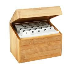 #Index_Card_holder securely holds up to 300 index cards. Built in ridges keep vards standing. Cardboard storage boxes with metal index card holders on a white background.