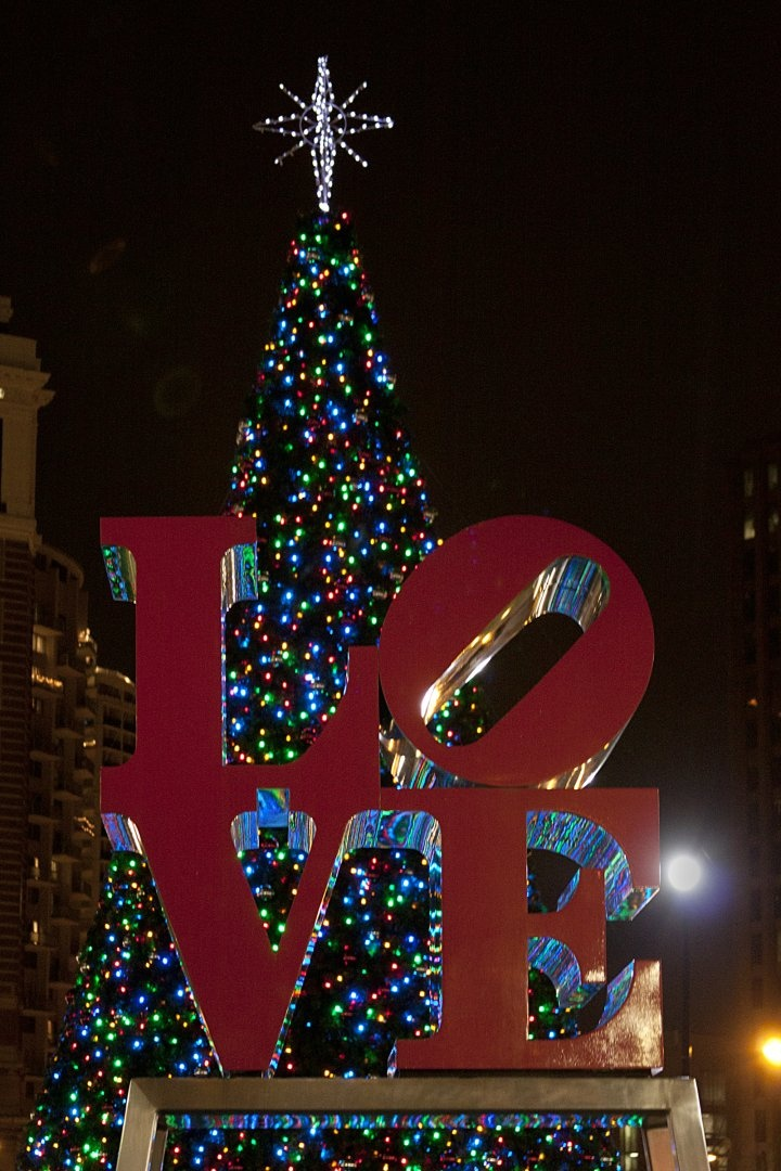A Christmas tree on display behind Robert Indiana's famous Love statue in Philadelphia's aptly named Love Park.  (Photo by M. Fischetti for GPTMC)