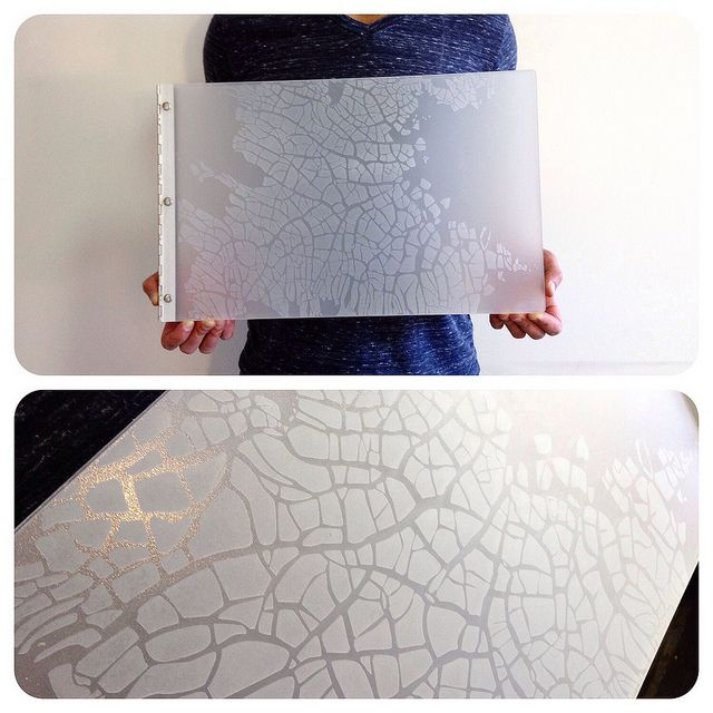 """Custom graphic book portfolio book with """"cracked ice"""" engraving look on frosted clear by kloportfolios.com"""