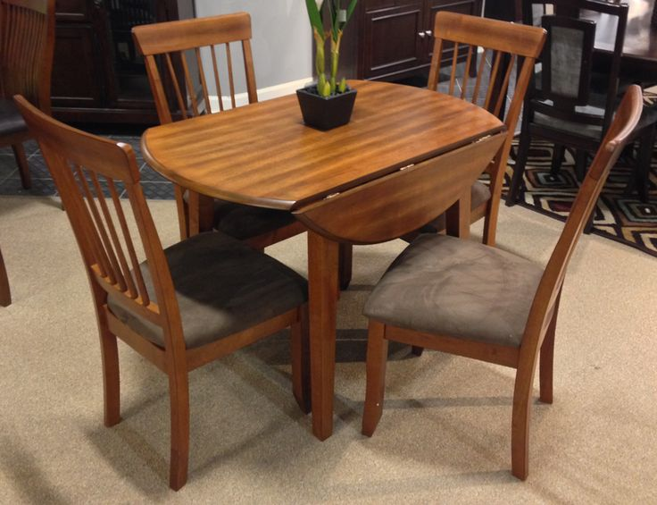 The Rich Country Style Of Berringer Dining Room Collection Reflects Back To