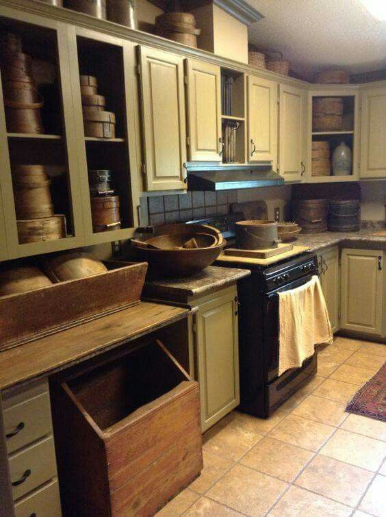 primitive kitchen filled to the brim with old wood buckets, boxes + bowls ♥