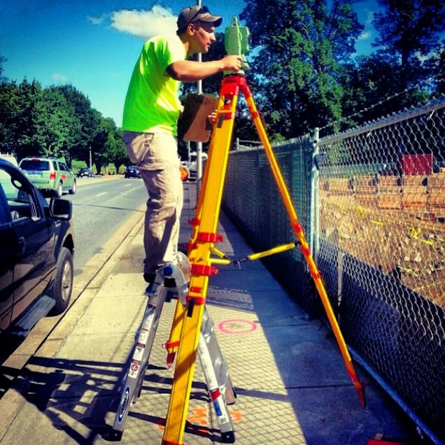 @IG:woody321cba using the Go-Go Gadget Legs to see over a fence while working on a survey monitoring project in Bethesda, Maryland, USA. #surveylife