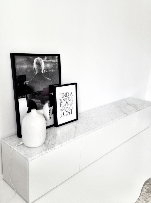 This is a good way to dress up your basic Ikea Besta storage units, just throw a marble table top and voila!              via       Have a ...
