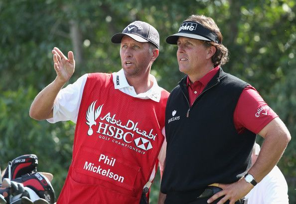"""Jim 'Bones' MacKay Photos Photos - Phil Mickelson of the USA takes advice from his caddie Jim """"Bones"""" MacKay (L) on the 17th tee during the third round of the Abu Dhabi HSBC Golf Championship at the Abu Dhabi Golf Cub on January 18, 2014 in Abu Dhabi, United Arab Emirates. - Abu Dhabi HSBC Golf Championship - Day Three"""