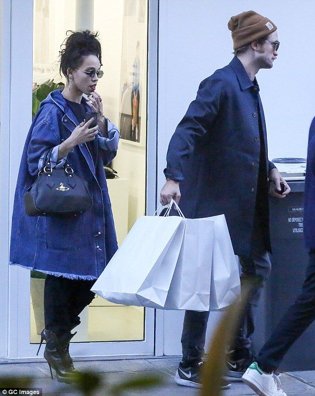 Stepping out: Robert Pattinson and new girlfriend FKA twigs shop in Paris on Tuesday after...