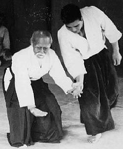 """Japanese martial art founded by Morihei Ueshiba, literally meaning """"way of harmony"""". It is characterized by use of throwing, locking and immobilizing techniques as opposed to violent striking methods. Of all martial arts it has the highest ethical basis."""