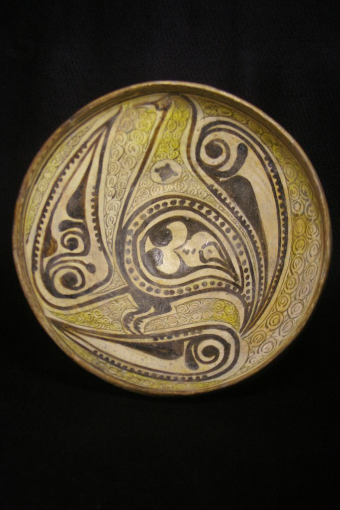 Bowl with stylized bird design 10th century Iran, Nishapur kilns earthenware coated with white slip; brown decoration