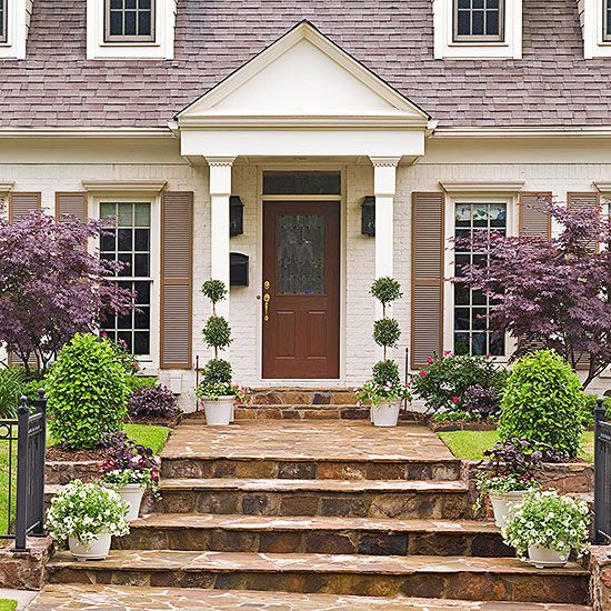 A medley of neutrals in a melange of textures -- ivory painted brick, gray-tan shutters, and golden-brown flagstone -- are easy hues to live with (without being boring): http://www.bhg.com/home-improvement/door/exterior/traditional-front-doors/?socsrc=bhgpin050514neutralzone&page=2