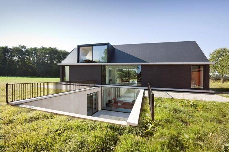 modern-barn-style-home-showcases-glazings-below-grade-ramp-1-ramp.jpg