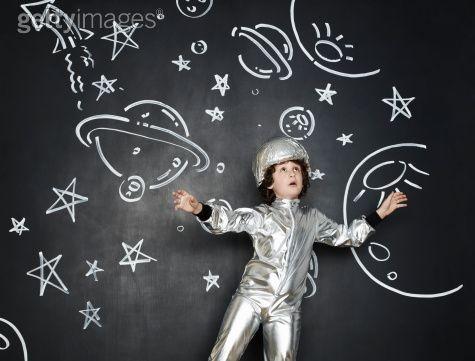 Boy dressed as an astronaut, or a girl like an astronaut!