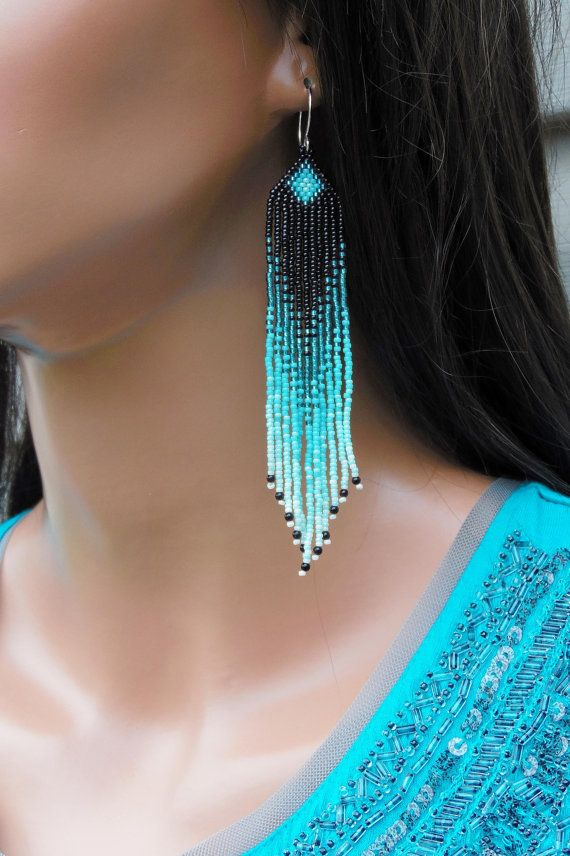 Black, metallic green, aqua, mint green and luster ecru seed beads make up these long fringe earrings. They are 4 1/2 long (including the