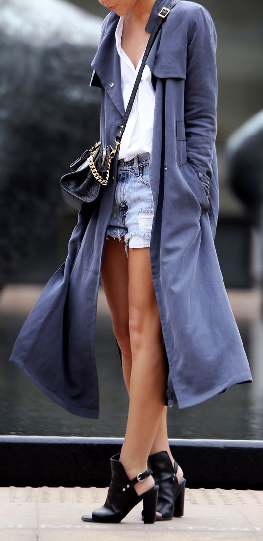 Just sexy how she is working the trench that are playing off the shoes. A must buy men. The House of Q