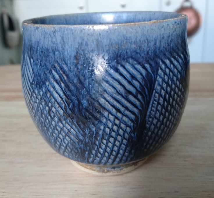 Photo: Another padded teabowl, this one is glazed with Field Mouse Brown, which is not brown at all in my mixing, rather purplish blue. Too much cobalt added I assume, it's quite difficult to measure out in small batches. Still, a pleasant glaze, has enough variation to remain interesting.