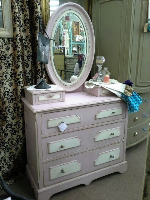 SOLD - This is an antique dresser with oval mirror. 3 large drawers in the base and two small keepsake drawers on top. It has been painted a pale pink with creamy white accents. The dresser measures 39 inches across the front, 18 inches deep. It is approximately 66 inches tall, to the top of the mirror. It can be seen in booth D 8 at Main Street Antique Mall 7260 East Main St ( E of Power Rd ) Mesa 85207 480 9241122 open 7 days 10 till 530 Cash or charge 30 day layaway also available