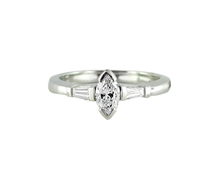 An 18ct White Gold, Marquise Cut and Baguette Cut Diamond Trilogy Ring