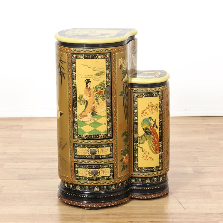 This cabinet is featured in a solid wood with a multi-color paint finish. This Asian-style side table has 2 spacious drawers, beautiful bird chinoiserie, and 2 cabinets with interior shelving. An eye-catching piece that's perfect for storing books! #asian #storage #cabinet #sandiegovintage #vintagefurniture