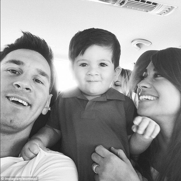 Family selfie: Messi (left) with Roccuzzo (right) and their son Thiago (centre) take a photo on holiday