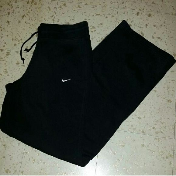 Womens black Nike sweatpants Gently used very warm and comfortable Nike drawstring sweats. Loose fitting Size Small. Overall good condition!  Make an offer!!! Nike Pants