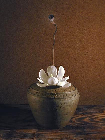 Lotus by Atsushi - ikebana The fruit of lotus and magnolia, in a miso pot from the Cham in Vietnam.